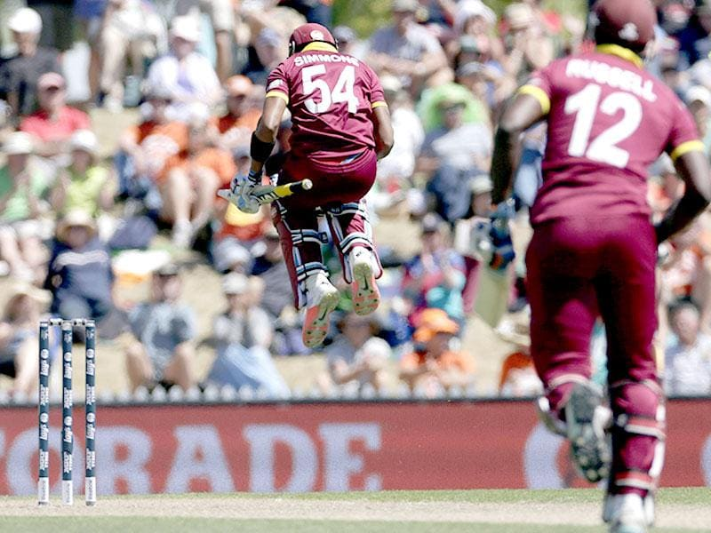 West Indies batsman Lendl Simmons celebrates his century with Andre Russell (R) during their Cricket World Cup match against Ireland in Nelson. Reuters