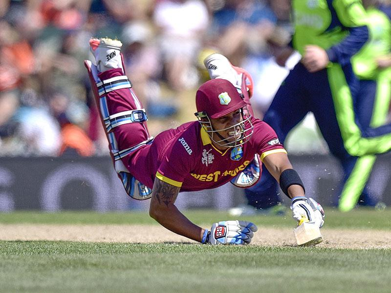 West Indies batsman Lendl Simmons dives making his ground safely during the Pool B 2015 Cricket World Cup match between Ireland and the West Indies at Saxton Park Oval in Nelson. AFP Photo