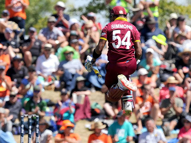 West Indies' Lendl Simmons jumps up after making 100 runs against Ireland during their Cricket World Cup pool B match at Nelson, New Zealand. AP Photo