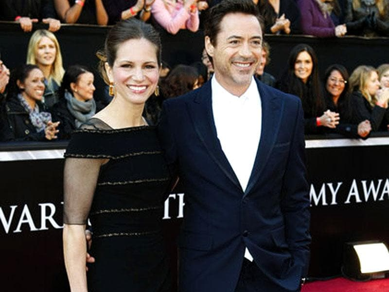 Robert Downey Jr and Susan Downey posed at the red carpet of 83rd Academy Awards, 2011