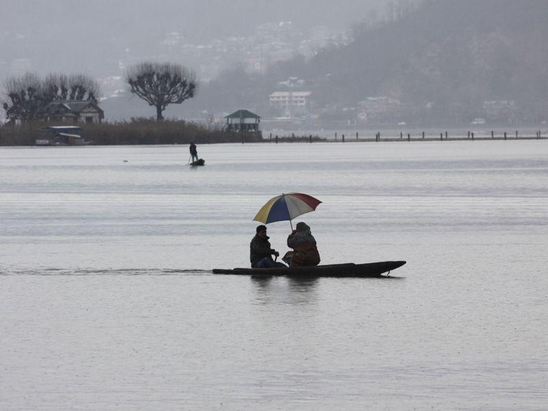 Tourists ride on traditional boats as clouds hover over the Dal Lake in Srinagar. Waseem Andrabi/HT