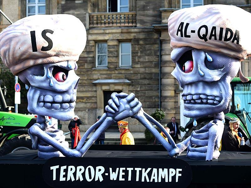 Figures depicting IS and al Qaeda are pictured reading 'terror competition' during the traditional Rose Monday carnival parade in the western German city of Duesseldorf. (AFP Photo)