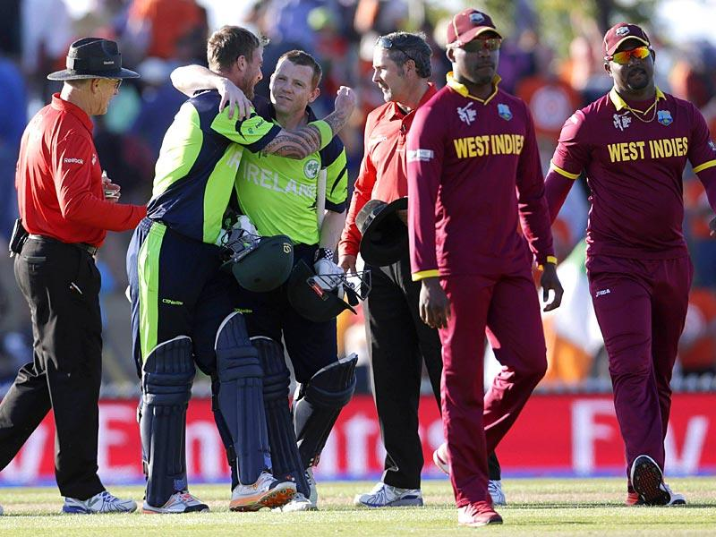 Ireland's John Mooney (2nd L) hugs teammate Niall O'Brien (3rd L) after beating the West Indies for the first time in their Cricket World Cup match in Nelson. (Reuters)