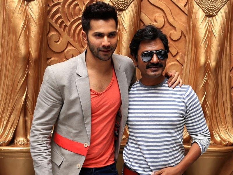 Varun Dhawan may rule the hearts of thousands of youngsters but Nawazudinn Siddiqui is no less. The duo poses during a promotional event for Badalapur in Bangalore. (AFP Photo)