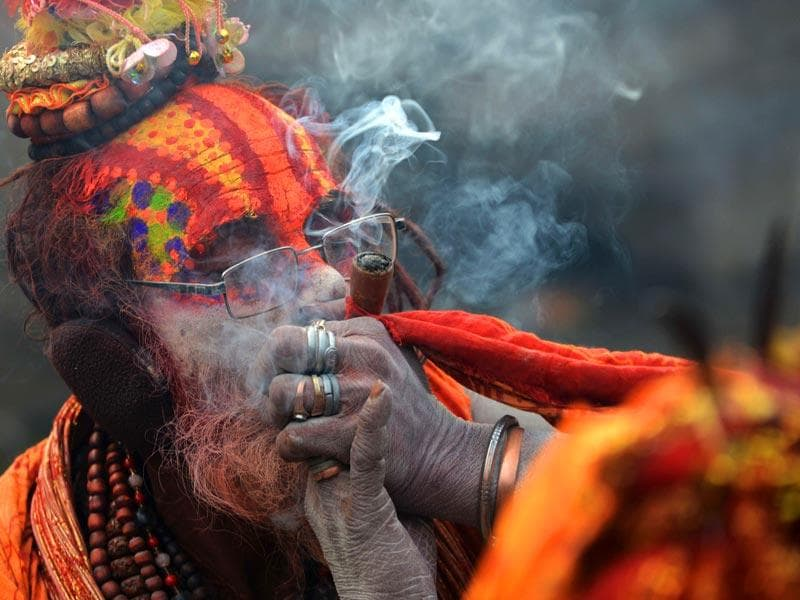 A Nepalese Hindu sadhu smokes marijuana from a clay pipe as a holy offering for Lord Shiva during the Shivaratri festival in Kathmandu. (AFP photo)