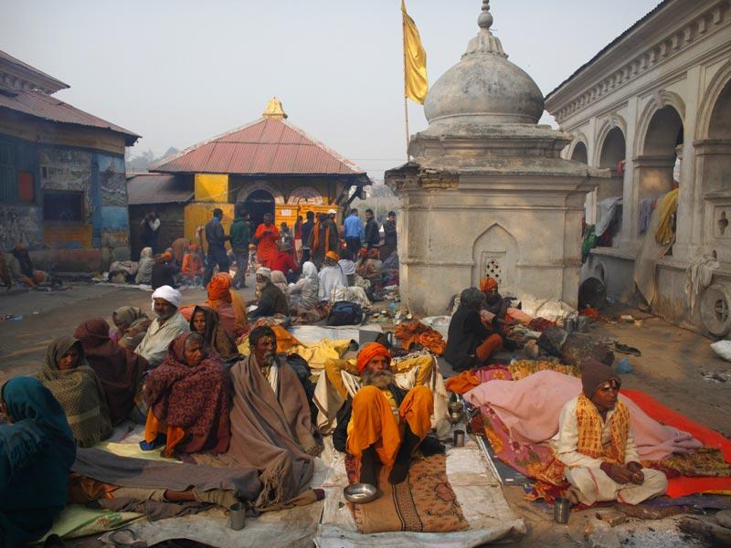 Saints and devotees take rest at the courtyard of the Pashupatinath temple during Shivaratri festival in Kathmandu. (AP photo)