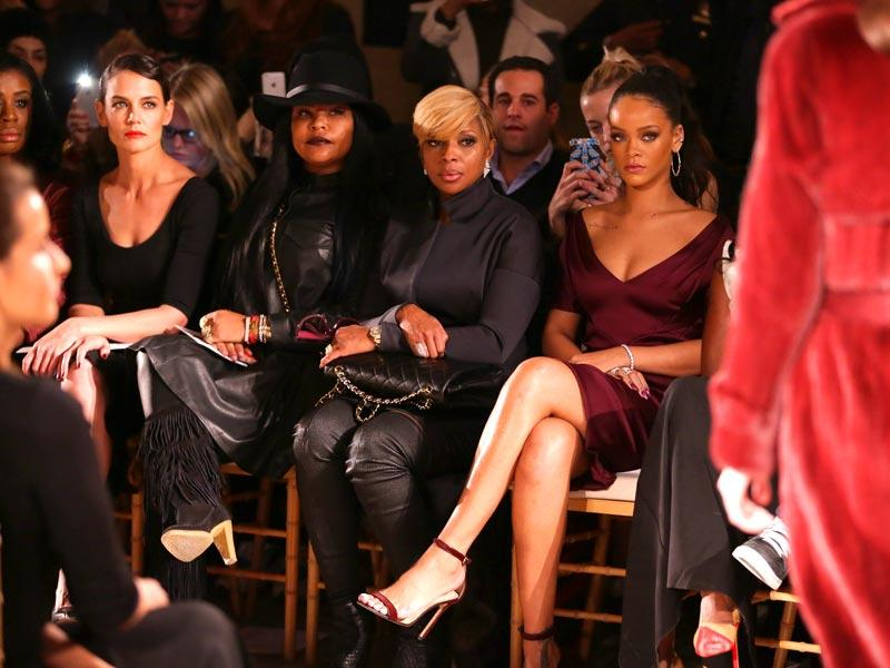 Actors Uzo Aduba, Katie Holmes, and singer Mary J Blige and singer Rihanna attend the Zac Posen fashion show. (AFP)