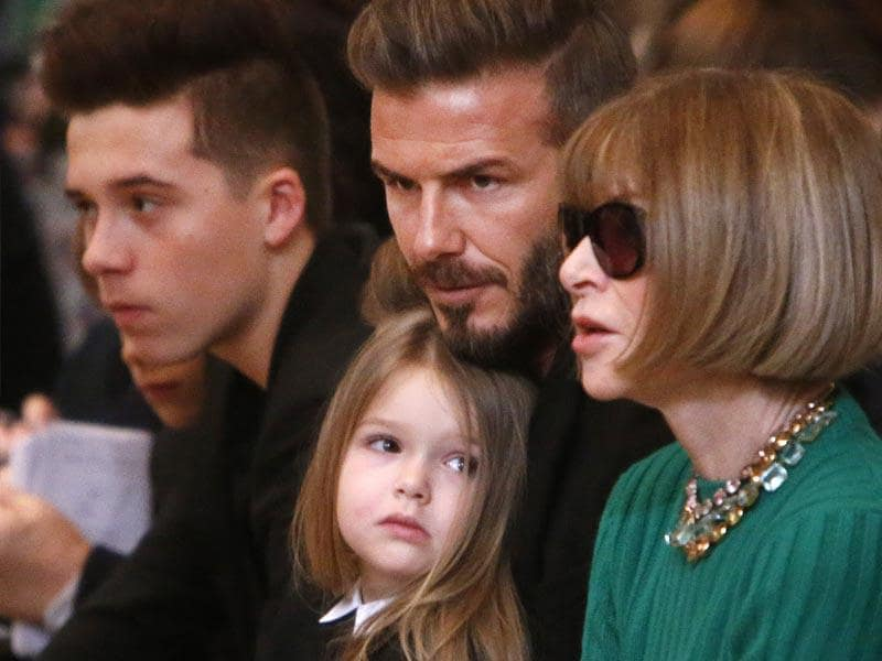 David Beckham sits in the front along with son, Brooklyn and daughter Harper, before the Victoria Beckham Fall 2015 collection show. (AP)