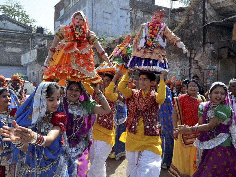 Artistes perform traditional 'Gangaur' dance during 'Shiv Barat' procession taken out on Mahashivratri, in Bhopal on Tuesday. (PTI photo)