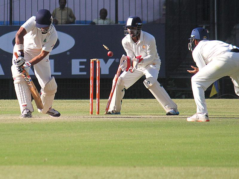 Assam batsman DS Jadhav in action on the second day of quarterfinal match between Karnataka and Assam, in Indore on Tuesday. (Shankar Mourya/HT photo)
