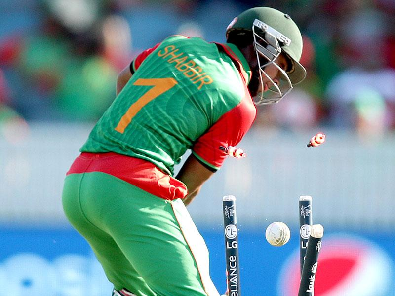 Bangladesh's Rahaman Shabbir is bowled during their Cricket World Cup Pool A match against Afghanistan in Canberra. (AP Photo/Rob Griffith)
