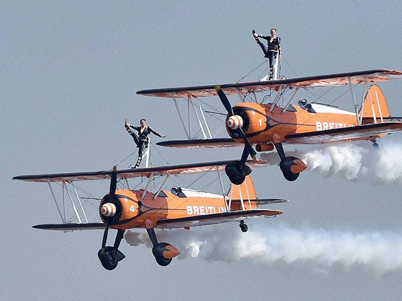UK's AeroSuperBatics team Breitling Wingwalkers performs during the inauguration of the Aero India 2015. (PTI Photo)