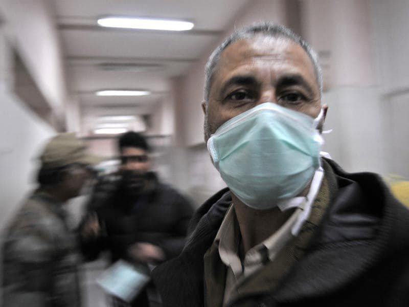 A man with a protective mask inside the Sher-e-Kashmir Institute of Medical Sciences hospital in Srinagar. Waseem Andrabi/HT