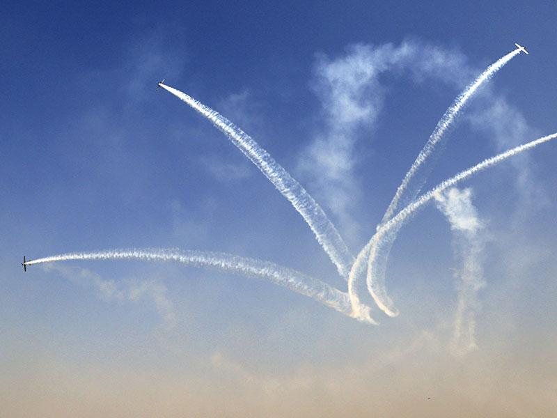 Russian aerobatic team Yakovlev performs at the inaugural function of Aero India 2015. (AP Photo)