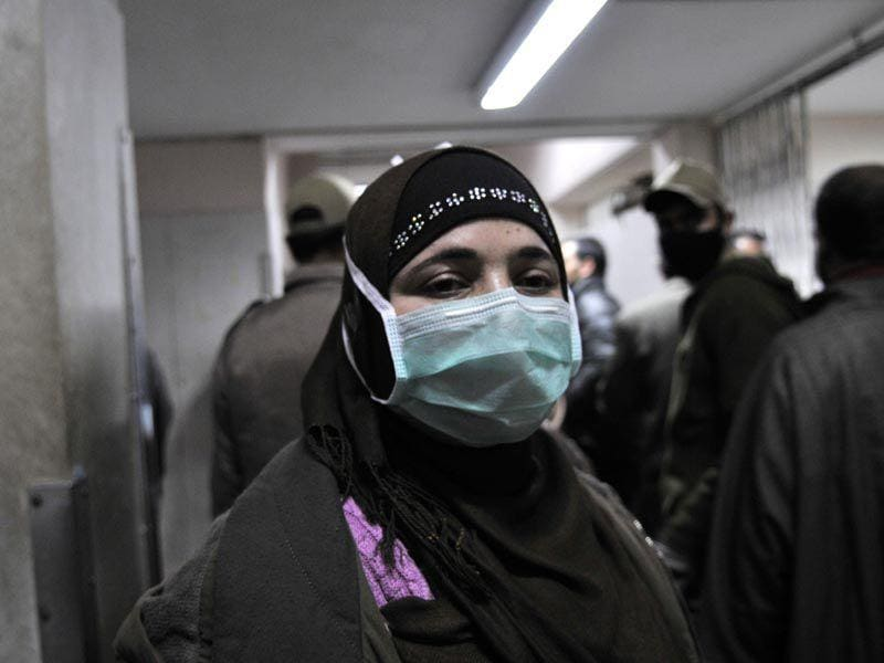 A women with a protective mask inside the Sher-e-Kashmir Institute of Medical Sciences hospital in Srinagar. Waseem Andrabi/HT