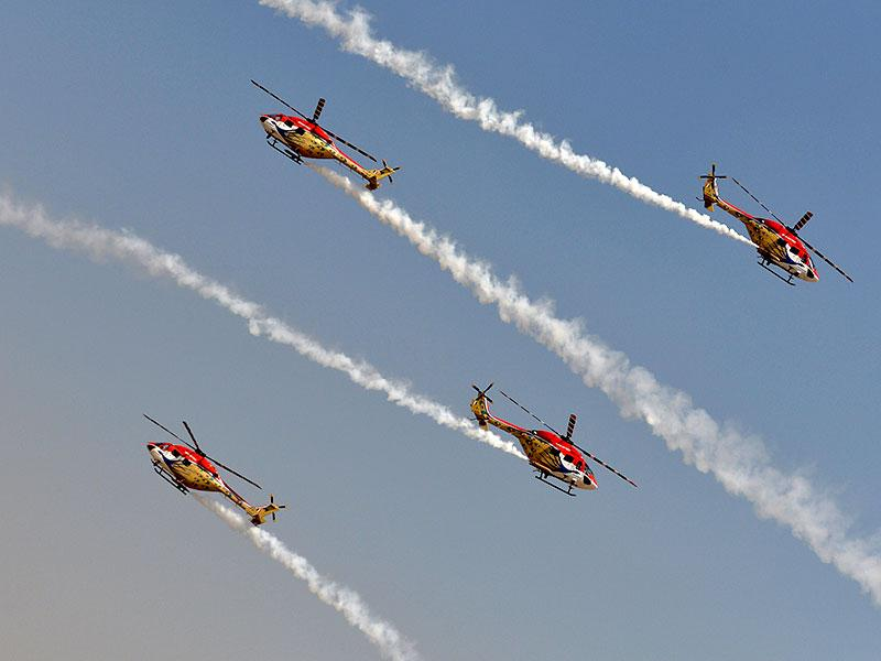 The Sarang aerobatics team of the Indian Air Force fly Advanced Light Helicopters (ALH). (AFP Photo)