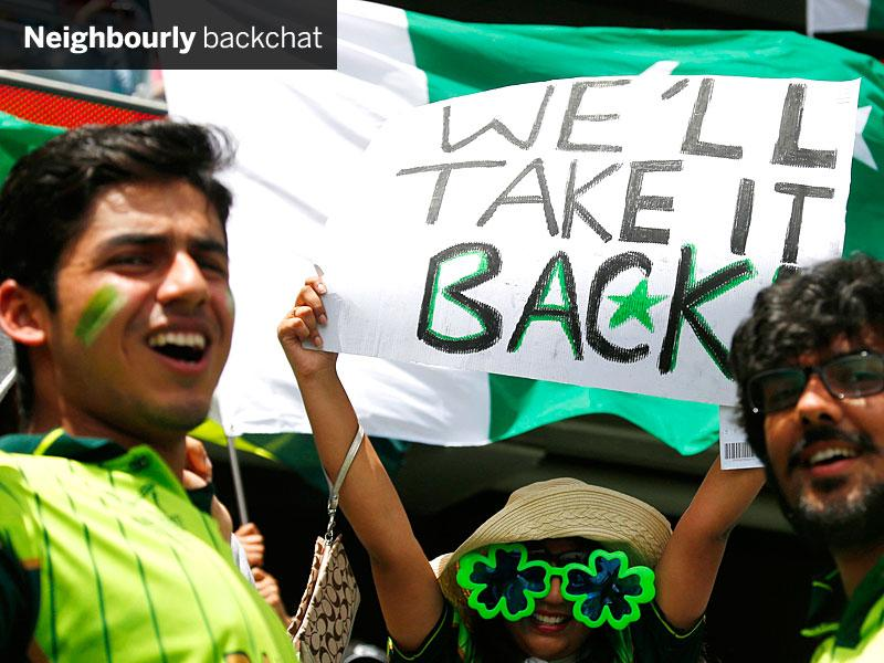 Pakistan fans cheer in the stands before their team's match against India in Adelaide on February 15. Their team did not back their talk. (Reuters Photo)