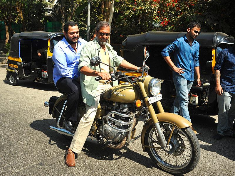 Nana Patekar, with his son Malhar Patekar as passenger, rides a 'bullet' motor-cycle to promote Ab Tak Chappan 2. (AFP Photo)