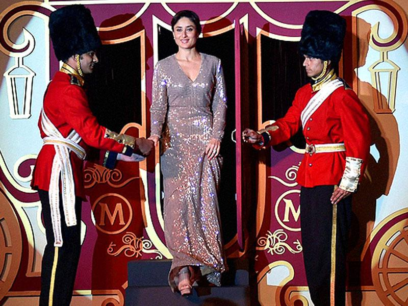 Bollywood actor Kareena Kapoor Khan walks off the stage at the launch of an ice cream bar in New Delhi. (AFP)