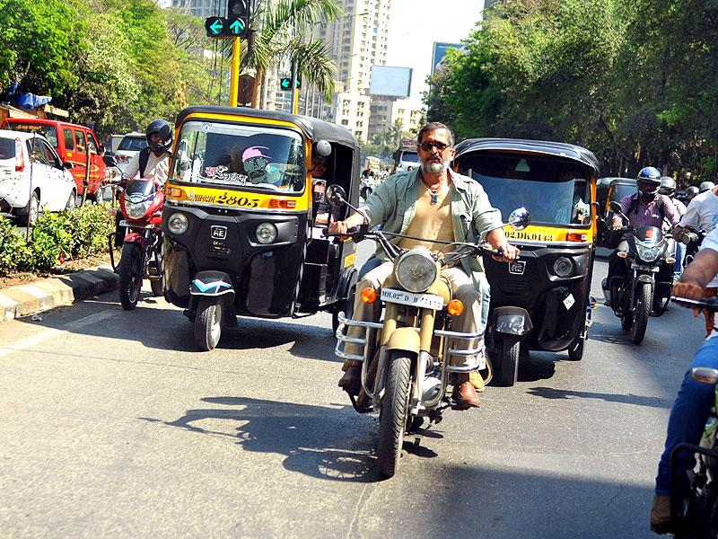 Nana Patekar takes a 'bullet-ride' for the promotions of Ab Tak Chappan 2, directed by Aejaz Gulab, in Mumbai on February 18, 2015. (AFP Photo)