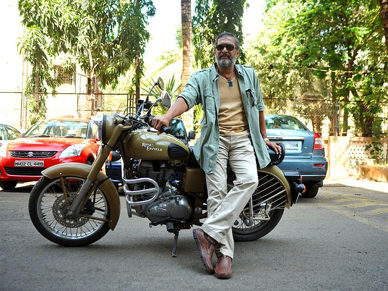 Nana Patekar took a 'bullet-ride' to promote Ab Tak Chappan 2, directed by Aejaz Gulab on February 18, 2015. (AFP Photo)