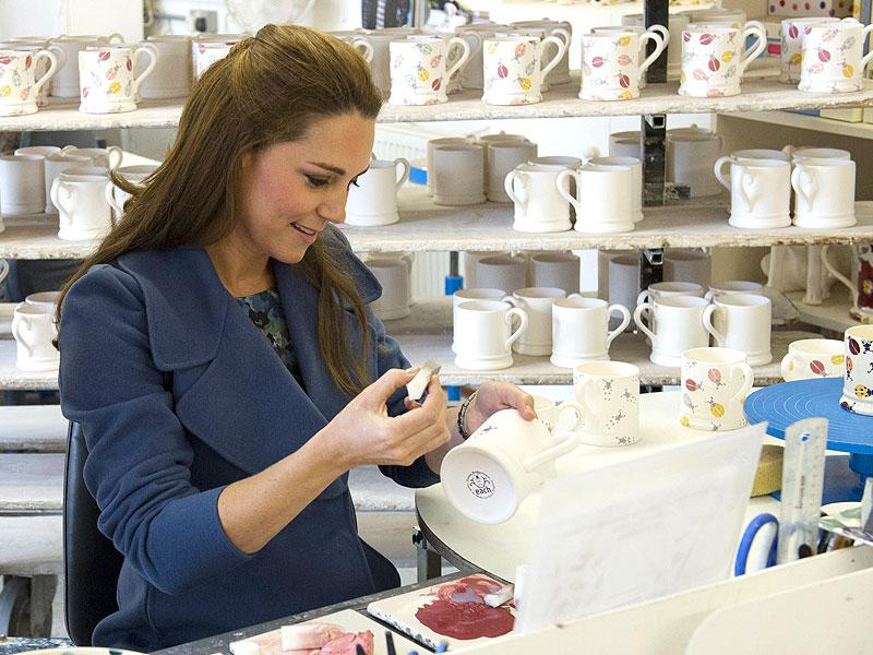 Britain's Catherine, Duchess of Cambridge helps decorating a mug as she visits the Emma Bridgewater pottery factory. (AFP)