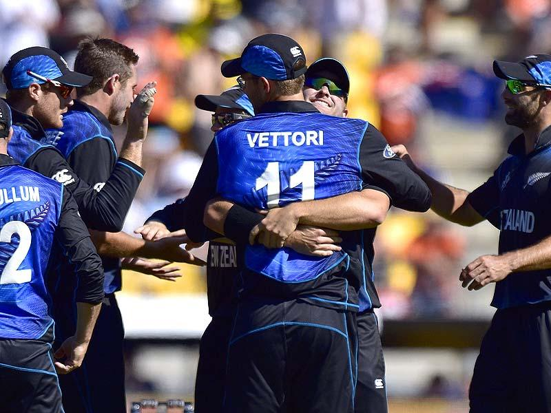 New Zealand players celebrate after taking a wicket against England in their 2015 World Cup match in Wellington. (AFP Photo)