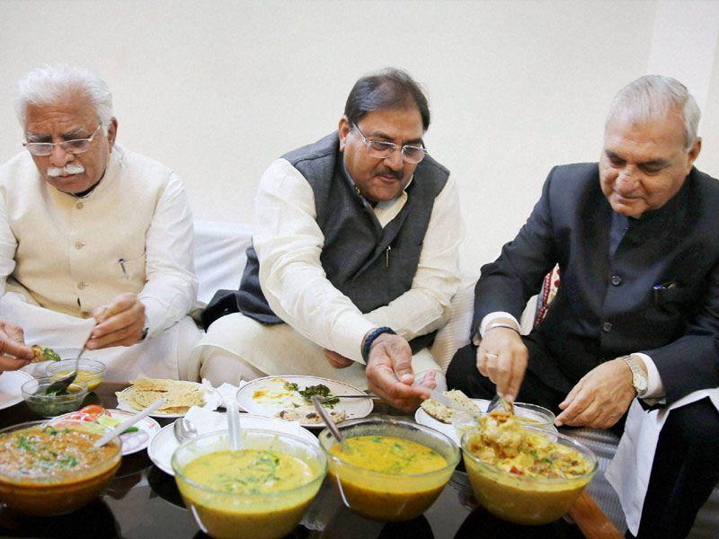 Haryana CM Manohar Lal Khattar (L), INLD leader Abhay Singh Chautala (C) and former CM Bhupinder Singh Hooda at a lunch meet in Chandigarh on Friday. PTI Photo