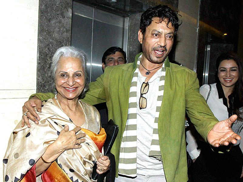 Bollywood actors Irrfan Khan and Waheeda Rehman interact the screening of film Qissa in Mumbai on Thursday. (PTI)