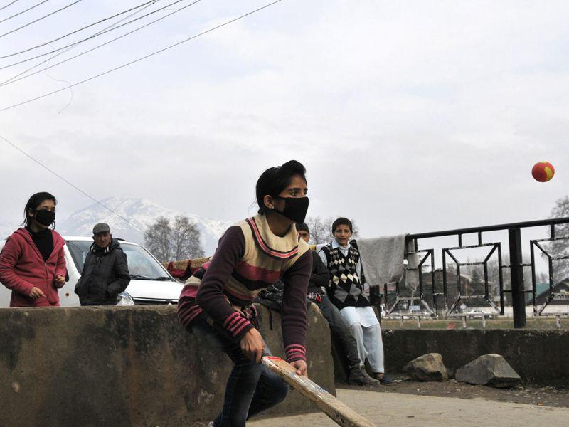 A Kashmiri girl wearing masks to keep away from the threat of Swine flu in Srinagar. Waseem Andrabi/HT