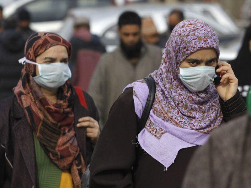 Kashmiri women wearing masks to keep away from the threat of Swine flu outside the hospital in Srinagar. Waseem Andrabi/HT