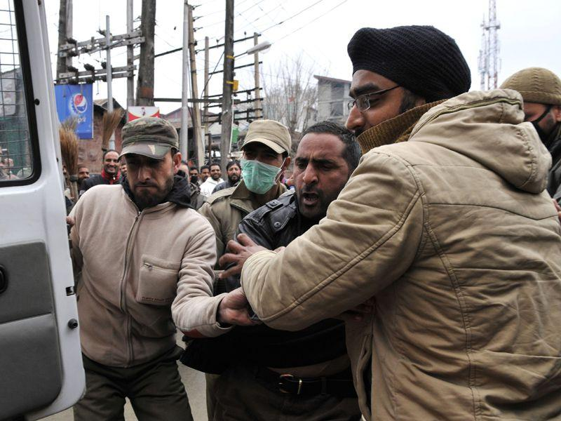 Kashmiri govt employee of Housing and Urban Local Bodies department shouts slogan as police detained him during a protest march in Srinagar. Waseem Andrabi/HT