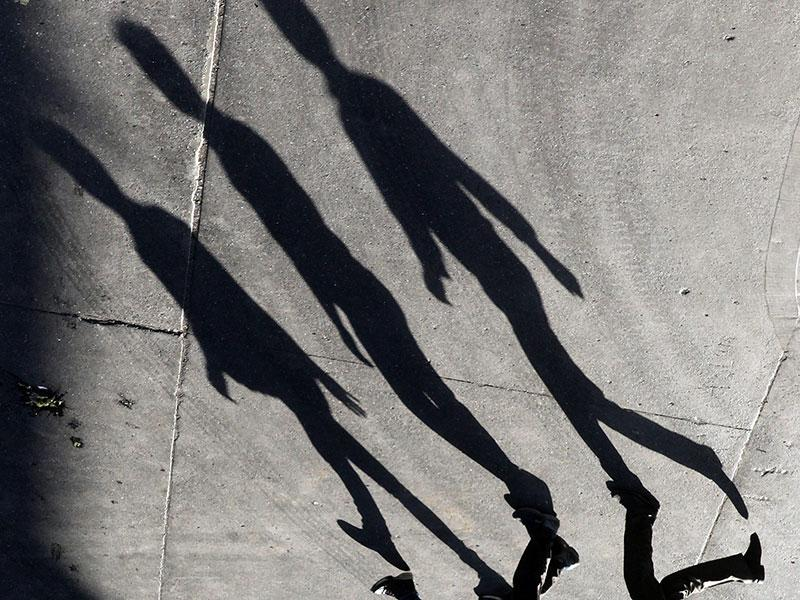 The shadows fall behind you: People walk along as their shadows fall on the road in Mumbai. (Pratham Gokhale/HT photo)
