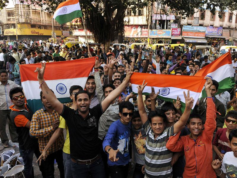 People celebrate India's victory over South Africa in World Cup cricket tournament, in Indore on Sunday. (Arun Mondhe/HT photo)