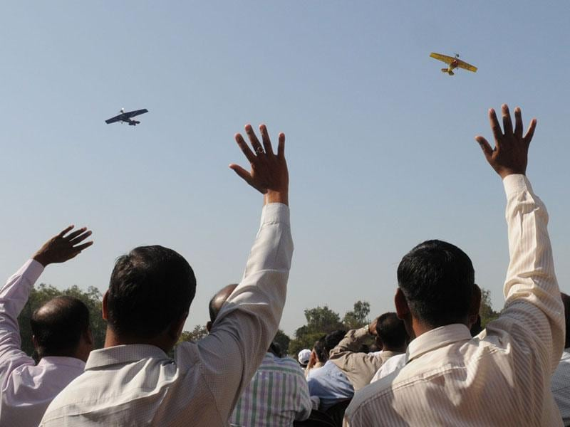 Members of the army microlight expedition team wave during airshow in Bhopal on Sunday. (Mujeeb Faruqui/HT photo)