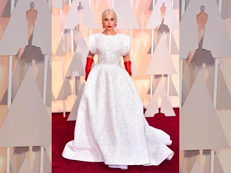 Lady Gaga was uncharacteristically sombre in a shimmering white dress and scarlet gloves. (Twitter)