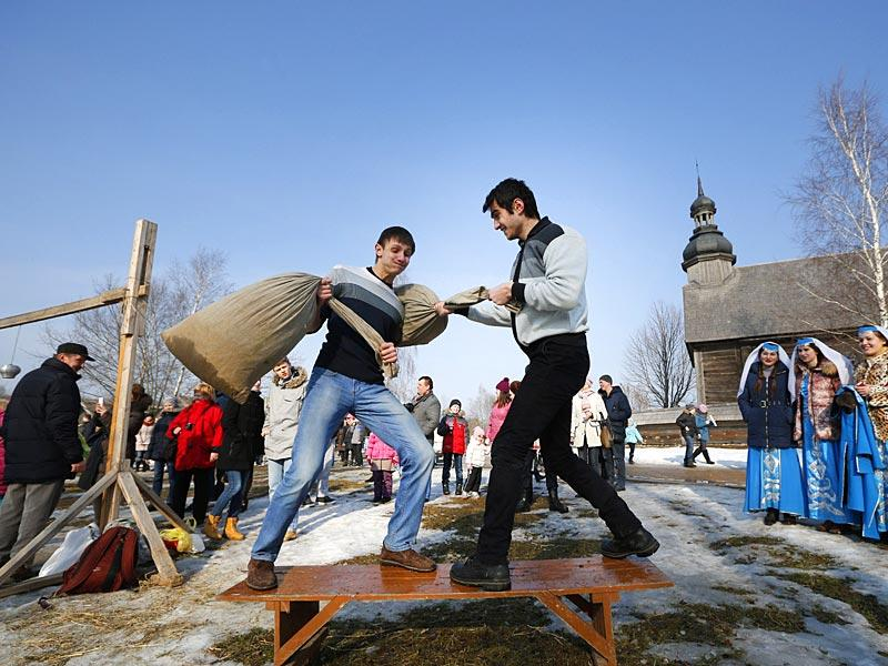 Young men fight with hay stuffed bags during festivities to mark Maslenitsa celebrations, or Shrovetide, in the village of Ozertso, in outskirts of Minsk, Belarus. (AP photo)