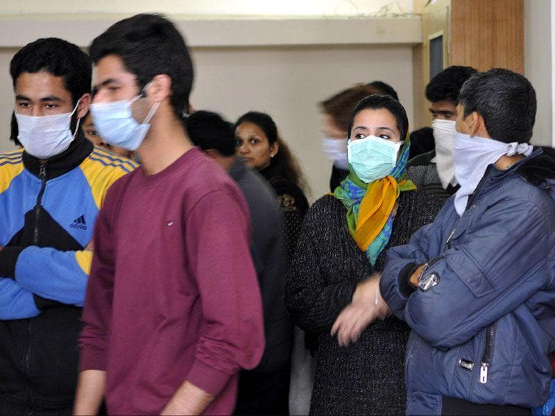 Patients wearing mask as a precaution measures against swine flu virus, waiting for their turn for an checkup at an OPD in Jammu. Nitin Kanotra/HT