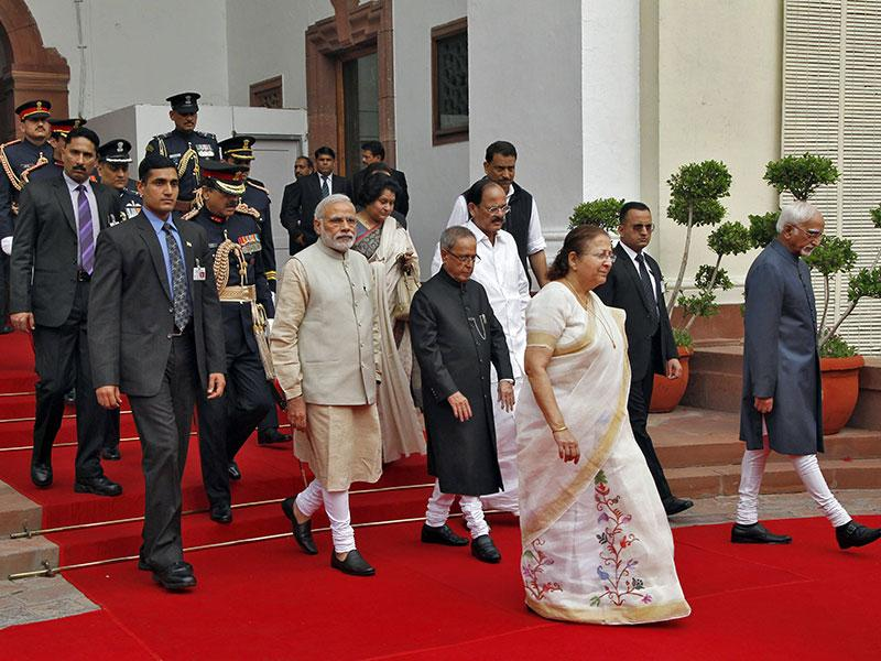 Prime Minister Narendra Modi (centre L), President Pranab Mukherjee (centre R), Lok Sabha speaker Sumitra Mahajan (3rd R) and vice-president Hamid Ansari (R) walk inside the Parliament premises as they arrive to attend the first day of the budget session. (Reuters)
