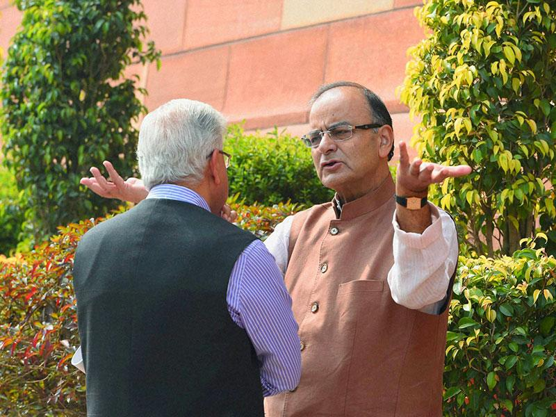 Finance minister Arun Jaitley with Congress MP Ashwani Kumar on the first day of the budget session in New Delhi. (PTI Photo)