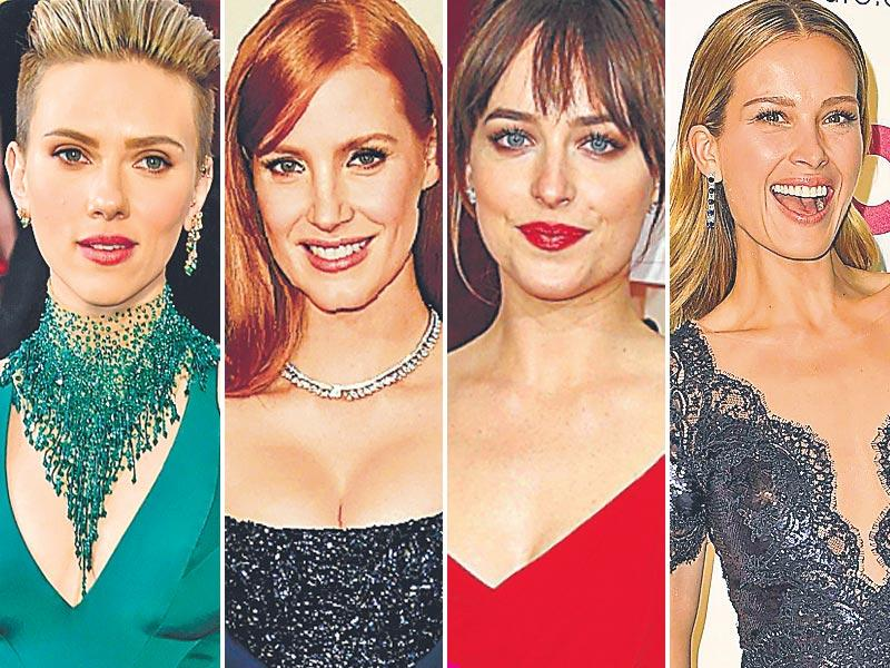 Neck deep in style: Actor Scarlett Johansson's dramatic neck adornment, and actor Jessica Chastain's beaded bodice gave a playful spin to their glam gowns. Actor Dakota Johnson's red Saint Laurent gown had a quirky knotted diamond strap, while model Petra Nemcova's cut-out lace neck also made for head turning style.