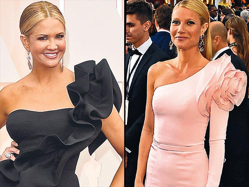 Ruffle power: Actor Gwyneth Paltrow (R) opted for a one-sleeved Ralph & Russo gown with a large ruffled rosette. Indian designers Gauri and Nainika Karan's gown also made it to the red carpet. TV host Nancy O'Dell (L) wore a black gown with ruffle detailing created by the duo.