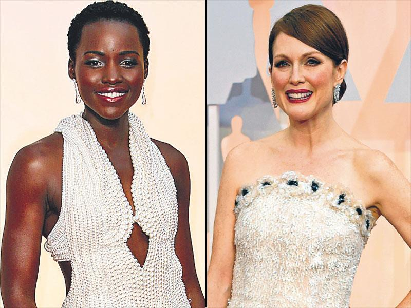 Old-world elegance: While fashion's darling Lupita Nyong'o (L) wowed everyone in her pearl encrusted Calvin Klein dress, actor Julianne Moore (R) rocked a Chanel gown made with floral detailing of organza, tulle and sequins.