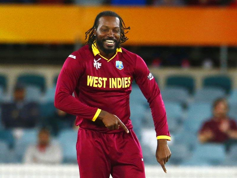 West Indies' Chris Gayle celebrates the wicket of Zimbabwe's Stuart Matsikenyeri during their 2015 Cricket World Cup match at Manuka Oval in Canberra. (Reuters Photo)
