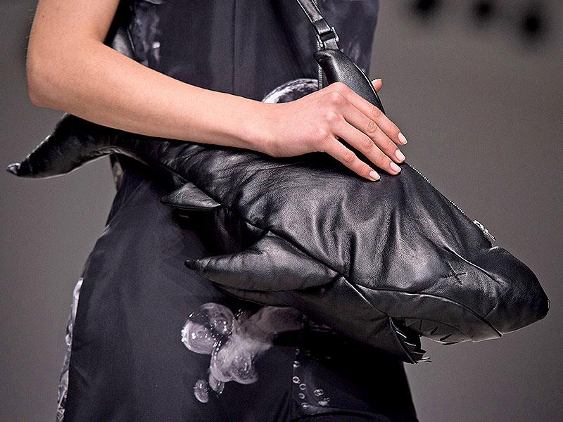 Accessories took on a dangerous element at Christopher Raeburn, where one model took this shark handbag out on to the runway.