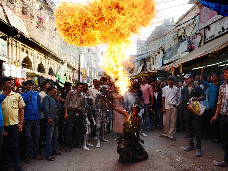 Allahabad: An Indian Hindu devotee demonstrates his fire skills during a religious procession to mark the Hindu festival of Maha Shivratri in Allahabad on February 17, 2015. Hindus mark the Maha Shivaratri festival by offering special prayers and fasting to worship Lord Shiva. (Photo: AFP)