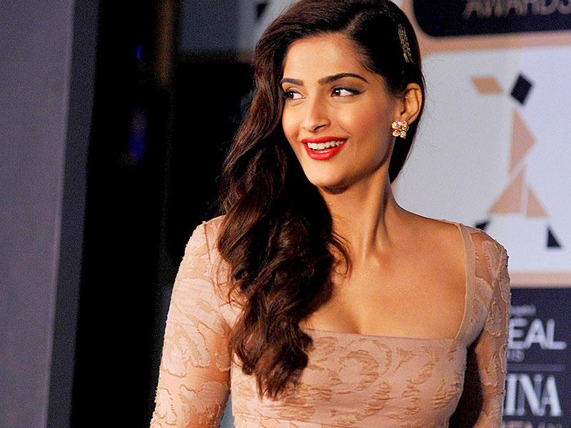 Can I leave already? I'm happy just thinking about the relief! : Sonam Kapoor at an awards announcement ceremony in Mumbai on February 24, 2015. (AFP Photo)