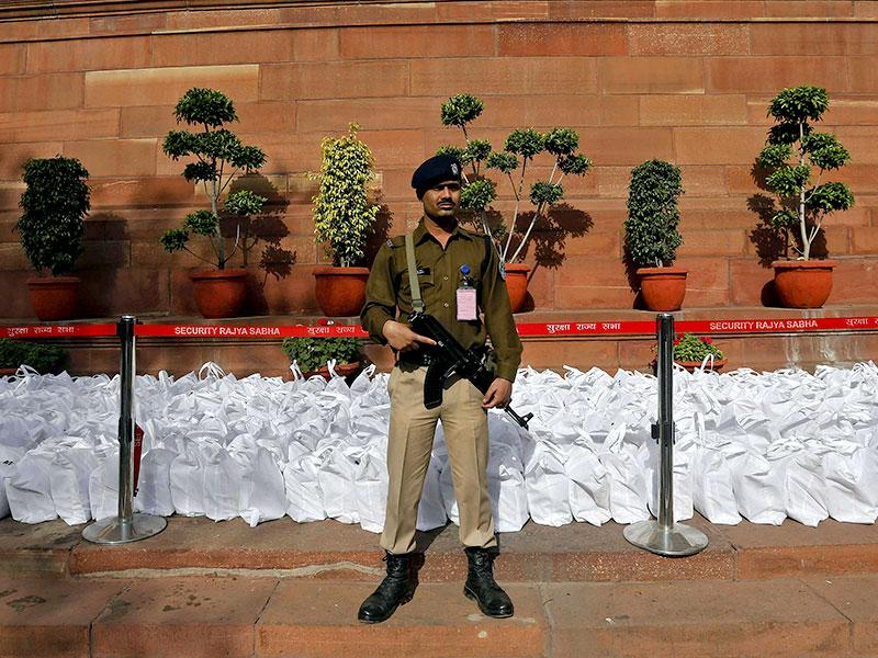 A security personnel stands guard near bags containing the railway budget papers at the Parliament in New Delhi. (Reuters)