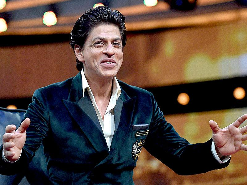 Shah Rukh Khan gestures during the launch of a new TV show India Poochega – Sabse Shaana Kaun? in Mumbai. (AFP Photo)