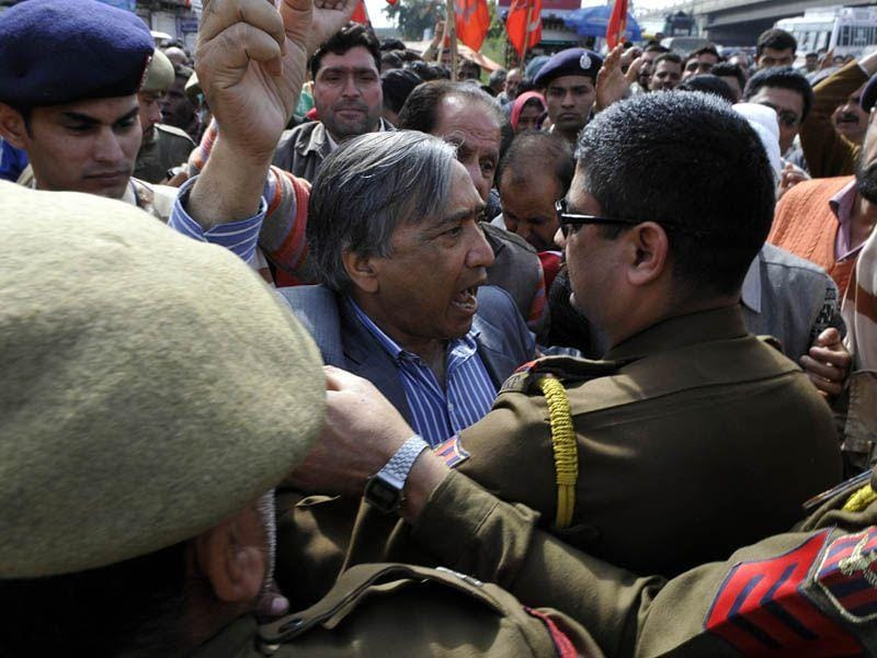 J-K police trying to stop CPI(M) president MY Tarigami during an protest against the government in Jammu on Thursday. Nitin Kanotra/HT